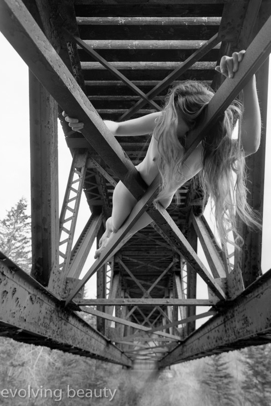 nude art model on a bridge